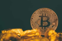Buy BTC image with physical Bitcoin gold nuggets and black background